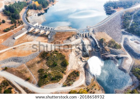 Spillway of Jindabyne lake power hydro dam on Snowy River in Snowy Mountains of Australia - aerial top down view. Royalty-Free Stock Photo #2018658932