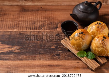 Close up of Moon cake yolk pastry, mooncake for Mid-Autumn Festival holiday on wooden table background Royalty-Free Stock Photo #2018722475