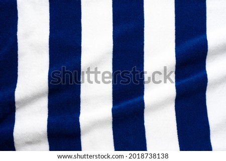 Blue stripes beach towel  mock up isolated on white background, flat lay top view shot Royalty-Free Stock Photo #2018738138