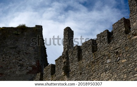 Defensive walls and towers of the castle against the cloudy sky. High quality photo Royalty-Free Stock Photo #2018950307