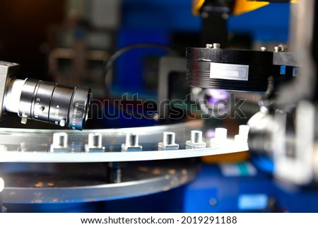 High-quality control in manufacturing optical sorting machine for fasteners nuts in product line Royalty-Free Stock Photo #2019291188