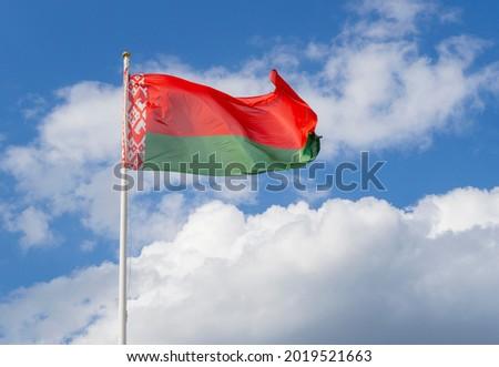 Flag of Belarus on flagpole waving against blue sky Royalty-Free Stock Photo #2019521663