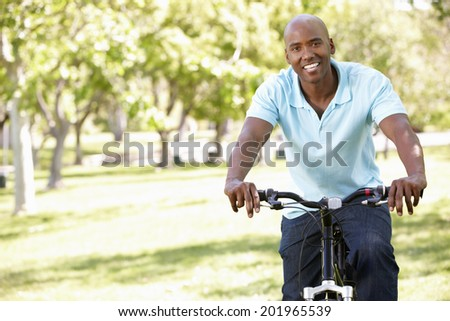 Young  man cycling in park #201965539