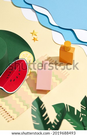Sunbathing on an carpet at the pool during summer vacation. Paper craft beach