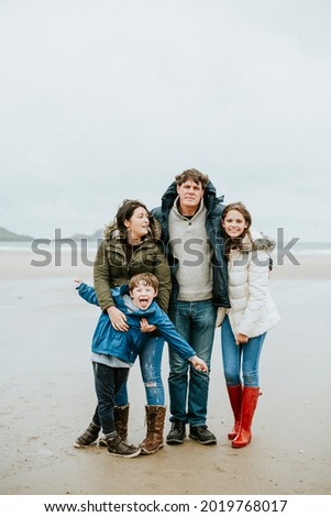 Cheerful family portrait at the beach