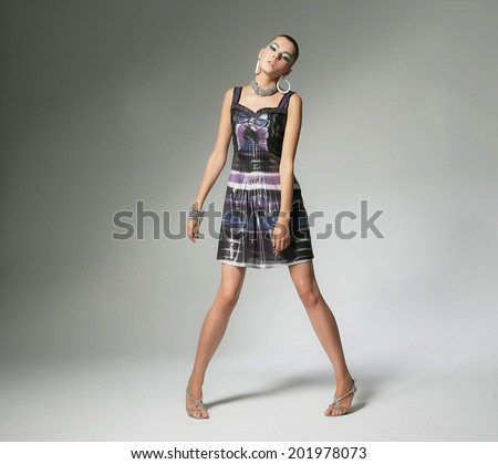 full-length portrait of a styled professional model �light background #201978073