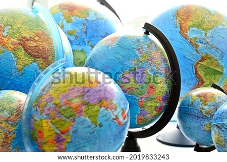 Saint Petersburg, Russia-August, 2021School globes, three-dimensional models of the planet Earth. Geographical globe. A model of the planet Earth with continents, continents, islands, seas and oceans  Royalty-Free Stock Photo #2019833243