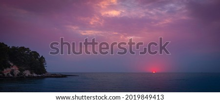 Moody pink and purple sunset seascape over Old Silver Beach in Falmouth on Cape Cod Royalty-Free Stock Photo #2019849413