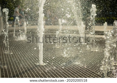 A fountain in the street. Water jets in the summer in the city. Splashing fountain on a sunny day. Royalty-Free Stock Photo #2020200518