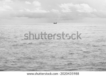 Black and white pic. A boat in sea. Alone. background