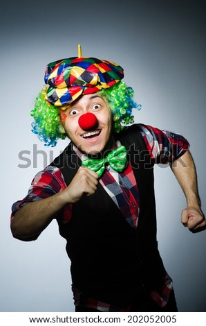 Funny clown against the dark background #202052005
