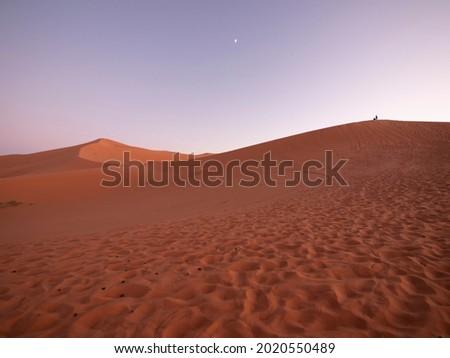 Sand dunes of Merzouga ergs at sunset Royalty-Free Stock Photo #2020550489