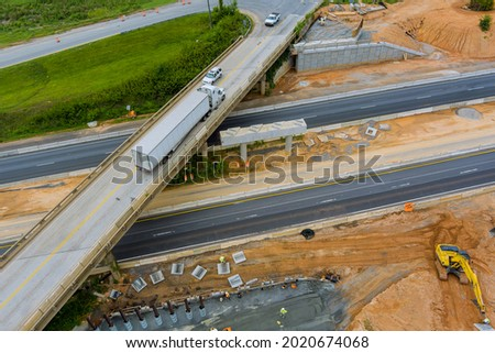 Overhead view of under construction works in highways of a bridge over a 85 interchange freeway Royalty-Free Stock Photo #2020674068