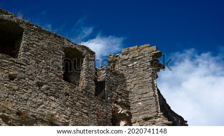Ruins of an old castle against a blue sky. High quality photo