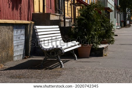 white wooden bench in the street, park bench, break. High quality photo Royalty-Free Stock Photo #2020742345