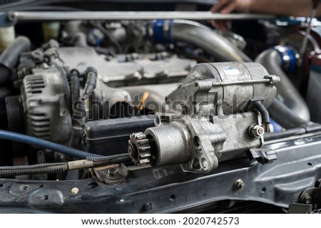 Close-up of an Old Used Car Starter motor. Royalty-Free Stock Photo #2020742573