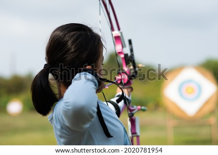 Children  learn compound bows in archery lessons. Royalty-Free Stock Photo #2020781954