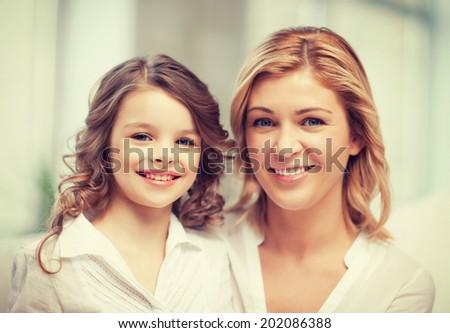 bright closeup picture of mother and daughter #202086388