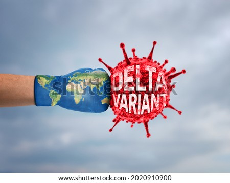 World Fight against corona virus, coronavirus vaccination concept. Hand with boxing gloves fight with Delta variant Corona Virus. Coronavirus outbreak and influenza concept.