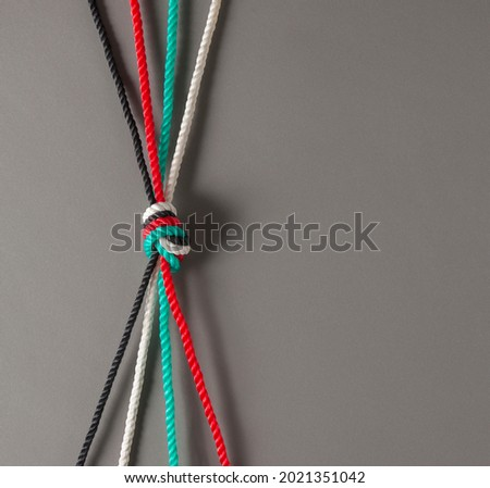 Conceptual photo for 'unity' of Emirati citizens. UAE flag color ropes tied together to connote 'strength' and 'togetherness'.