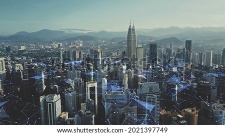 Digital network connection lines of Kuala Lumpur. Financial district and business centers in smart urban city in Asia. Skyscraper and high-rise buildings at night. Royalty-Free Stock Photo #2021397749