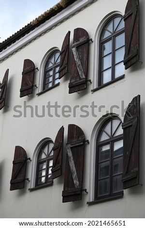a fragment of the facade of a historic building with rhythmically arranged arched windows Royalty-Free Stock Photo #2021465651