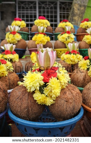 Mysuru,Karnataka,India-August 4 2021;A picture of religious ritual articles consisting of flowers,camphor,incense sticks and coconuts in a basket outside a Hindu temple in Mysuru, India.