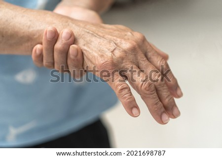 Guillain-Barre Syndrome GBS, Peripheral Neuropathy pain in elderly patient on hand, fingers, sensory nerves with numb, muscle weakness from chronic inflammatory demyelinating polyneuropathy