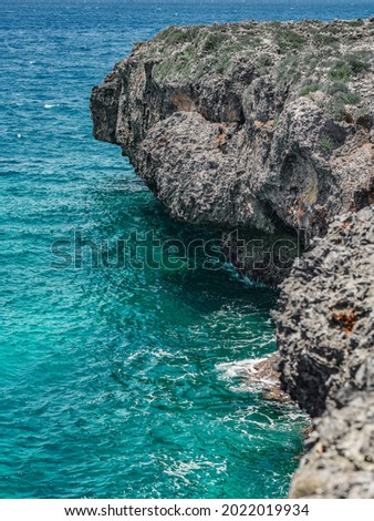 The photo shows the Atlantic Ocean with a rocky coast. The exotic island's beach contains many rocks and grottoes. The rocky landscape and the sea are a great vacation spot. Royalty-Free Stock Photo #2022019934