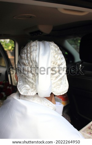 Javanese Wedding - batik headdress of a groom in Javanese culture with a white color theme that matches the outfit Royalty-Free Stock Photo #2022264950