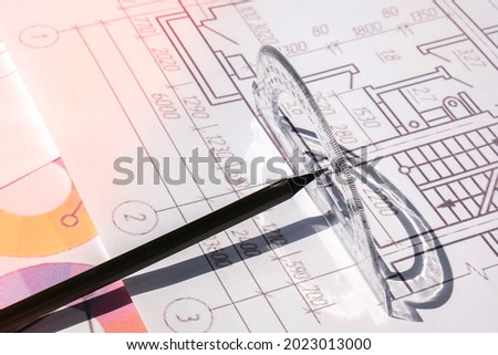 A pencil with a protractor. Architectural Project drawings with tools. Architects workplace. Engineering Interior designer's working table