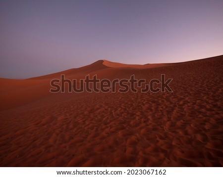 Sand dunes of Merzouga ergs at sunset Royalty-Free Stock Photo #2023067162