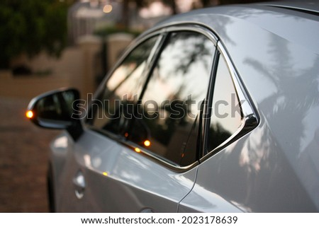 Evening light on the side of a new sedan Royalty-Free Stock Photo #2023178639