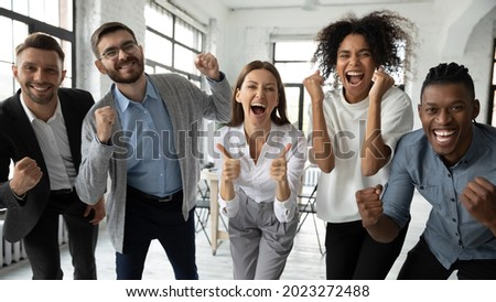 Portrait of overjoyed young diverse employees workers show thumb up recommend good quality company service. Smiling multiethnic colleagues celebrate shared business success or victory in office. Royalty-Free Stock Photo #2023272488