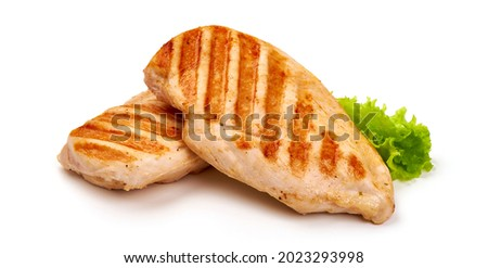 Grilled chicken fillet with tomato sauce, isolated on white background Royalty-Free Stock Photo #2023293998