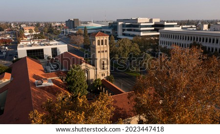 Sunset aerial view of historic downtown Bakersfield, California, USA. Royalty-Free Stock Photo #2023447418