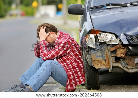 Man sitting near the car after accident #202364503