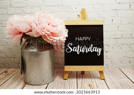 Happy Saturday typography text on easel wooden board