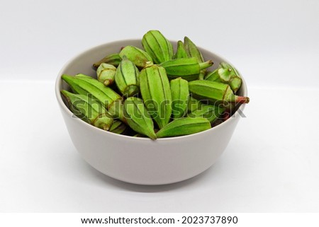 Egyptian Fresh and Green Okra isolated in White bowl