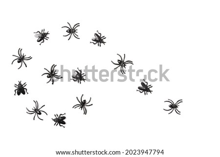 Cartoon Halloween background black insects on isolated white backdrop. Flat lay style. Halloween abstract background. Copy space.