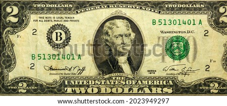 Large fragment of the Obverse side of 2 two dollars bill banknote series 1976 with the portrait of president Thomas Jefferson, old American money banknote, vintage retro, United States of America Royalty-Free Stock Photo #2023949297