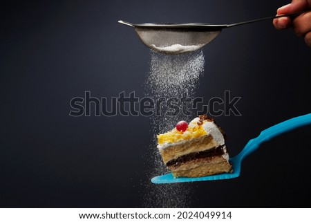 piece of cake covered with icing sugar