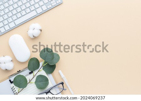 Office desk table top view with office supply, Beige table with copy space, Beige color workplace composition, flat lay Royalty-Free Stock Photo #2024069237
