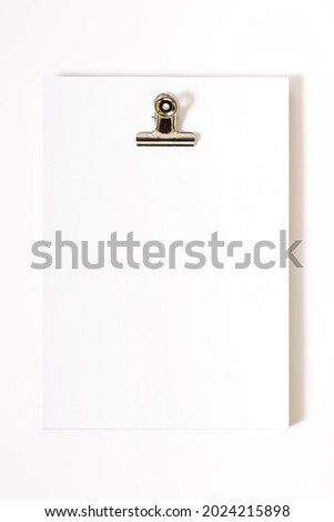 Studio photography of a packet of sheets of paper on a filing cabinet.Original photo to put advertising texts on white background.The photo is taken in vertical format.