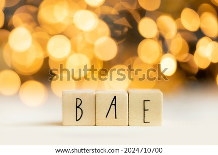 Bea acronym for before anyone else, best friend or loved one, social media term with gold bokeh background copy space