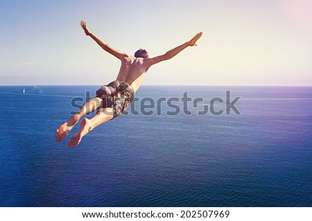 Cliff Diver Royalty-Free Stock Photo #202507969