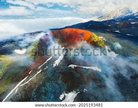 Volcano craters and black lava fields near Tolbachik volcano in Kamchatka peninsula, Russia. Aerial drone view. Kleshnya crater of Tolbachik volcano  Royalty-Free Stock Photo #2025193481