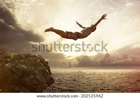 Cliff Diver Royalty-Free Stock Photo #202535962