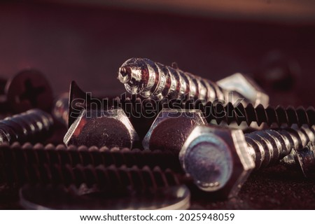 Macro photo of screws. Set of screws. Construction abstraction. Industrial background. Screws macro photo, screw background, steel screw, screw macro. Royalty-Free Stock Photo #2025948059