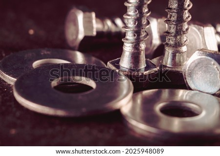 Macro photo of screws. Set of screws. Construction abstraction. Industrial background. Screws macro photo, screw background, steel screw, screw macro. Royalty-Free Stock Photo #2025948089
